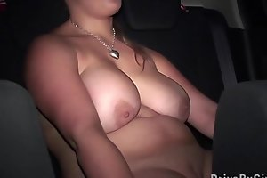 Big tits star Krystal Swift undressing in a car on the way to public gang bang