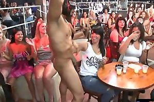 Gorgeous CFNM babes tugging strippers dong