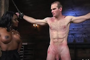 Muscled black mistress whips male slave