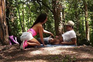 Brunette bimbo pleasuring black dude in the woods