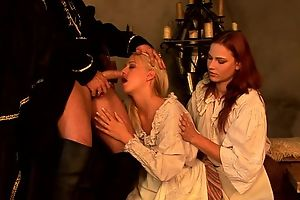 Insatiable redhead chick shares hard pecker with her blonde friend