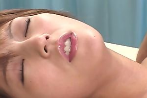 Passionate Japanese lady in ripped pantyhose enjoys riding hard dick