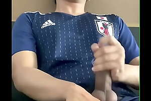 Cum shot Asian guy playing with his big cock in japanese football suit