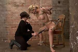 Busty slave tied to three spreader bars
